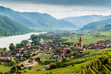 Scenic View into the Wachau with the river Danube and town Weissenkirchen in Lower Austria. - 210757827