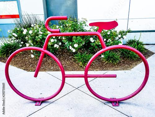 Plexiglas Fiets Red Bicycle near a public building