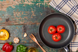 Include fresh organic vegetables and frypan on wooden floor - 210776686