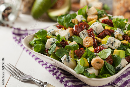 Italian salad with avocado, gorgonzola cheese.