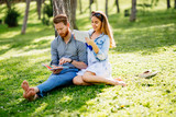 Beautiful couple studying together for exams - 210798434