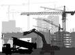 black digger in front of buildings and cranes