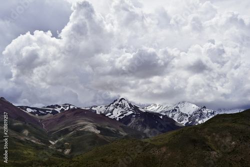 Plexiglas Grijze traf. Cloudy mountains of the Andes.