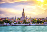 Thai Temple at Chao Phraya River Side, Sunset at Wat Arun Temple in Bangkok Thailand. Wat Arun is a Buddhist temple in Thon Buri District of Bangkok, Thailand, Wat Arun is among the best known of Thai