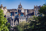 A view of Edinburgh Old Town, as seen from the famous Princes Street Gardens.  Scotland, UK.  The spire in the centre of the skyline is St Giles Cathedral. - 210829051