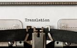 Text Translation typed on retro typewriter - 210855018