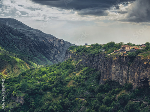 Fotobehang Zomer aerial view of beautiful mountains landscape with building over cliff on cloudy day, Armenia