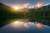 Sunrise at Smreczynski pond in the forest. - 210859054