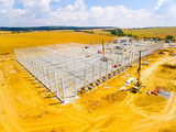Aerial view of construction site. Industrial theme from drone. Industry, development and investment in European Union. - 210886092