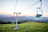 Landscape view on the beautiful Carpathian mountains with horeses and ski lift on the High Top near the Slavske village in Ukraine