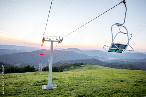 Landscape view on the beautiful Carpathian mountains with horeses and ski lift on the High Top near the Slavske village in Ukraine - 210886862