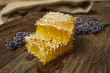 honeycomb on a wooden table close up - 210897432