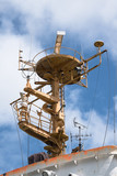 control tower with radar antenna and navigation equipment on an older industrial ship against the blue sky, vertical - 210908046