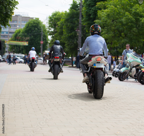 sport motorcycles on city road