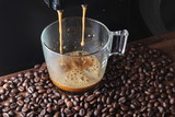 coffee glass coffee beanson a stone background a coffee machine - 210923413