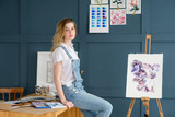 creative leisure. painting hobby. artful personality. talented girl sitting near a finished drawing