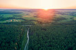 Aerial drone view of countryside, rural landscape with cloudy sky at sunset