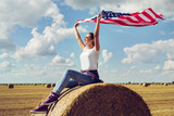 Young beautiful woman holding USA flag - 210948888