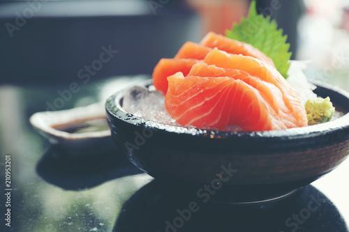 Leinwanddruck Bild Salmon sashimi on ice Japanese food