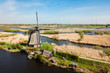 Leinwanddruck Bild - Aerial view of Netherlands rural landscape with windmills at fam