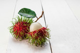 rambutan sweet fruit  on whit wooden teble. - 210965223