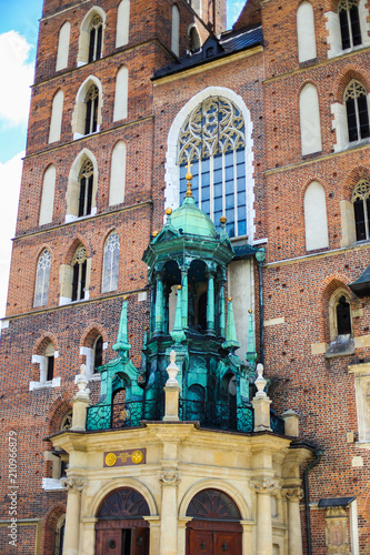Aluminium Krakau Krakow, Poland: close up of front of St. Mary's Basilica in Main Square. Concept of traveling to Europe and famous brick gothic church, architecture elements.