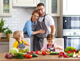 happy family with children preparing vegetable salad - 210970494