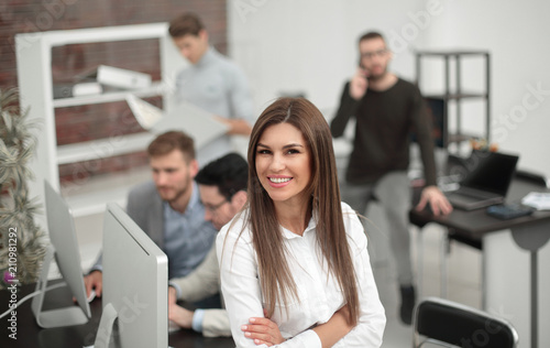 young business woman on the background of the business team.