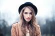 Leinwanddruck Bild - Beautiful young woman outdoors in park. Perfect female face closeup