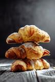 three croissants on dark wooden background close-up - 211008423