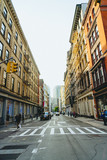 View down a street in New York City with tall buildings creating dramatic perspective