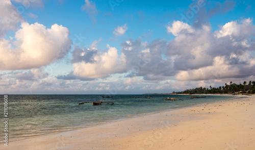 Fotobehang Zanzibar Beach on the east coast of Zanzibar. Traditional wooden sailing boats in Africa. Dhow.