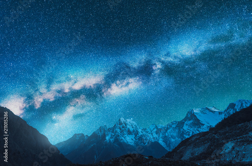 Milky Way and snowy mountains. Fantastic view with mountain ridge and starry sky at night in Nepal. Beautiful Himalayas. Night landscape with blue sky with stars and milky way. Galaxy.Space background © den-belitsky