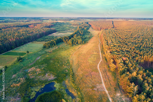 Aluminium Olijf Aerial view of countryside and river in the forest in evening. Sunset over the river