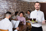 Portrait of adults in middle class restaurant and friendly waiter - 211055073