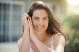 Portrait of attractive 40-year-old brunette woman - 211091044