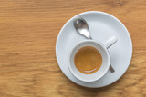 Perfect cup of espresso in white cup on wooden table - 211091414