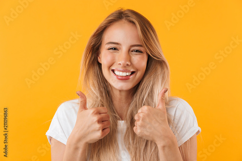 Portrait of an excited young blonde girl - 211096863