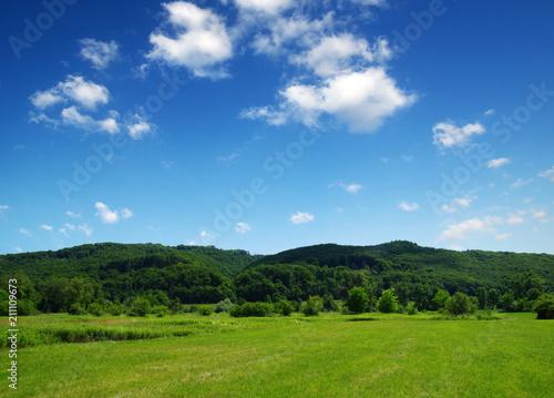 Mountain landscape with sun