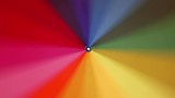 A multi-colored rainbow umbrella rotates around its axis, 4k - 211119853