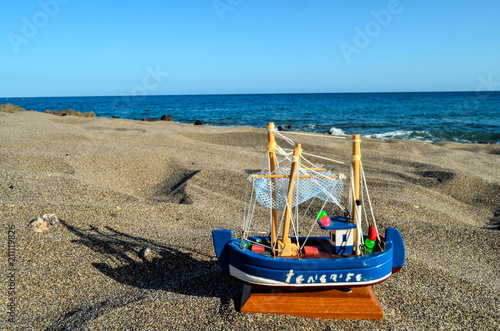 Toy Boat on the Sand Beach - 211119826