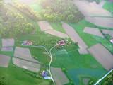 Luftaufnahme Die ersten Sonnenstrahlen über dem steirischen Hügelland.  - 211124688