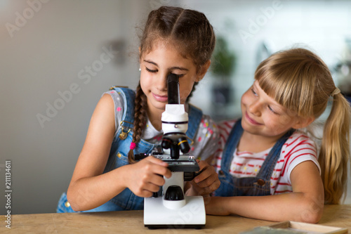 Girls with microscope