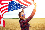 Young beautiful woman holding USA flag - 211144641