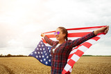 Young beautiful woman holding USA flag - 211144874