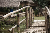 wooden bridge and traditional house in rural thailand