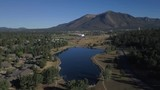 Aerial of a stylish neighborhood on a lake - 211150280