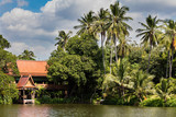 River house in a tropical forest in traditional Thai style