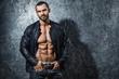 Handsome  bodybuilder showing his muscular body