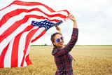 Young beautiful woman holding USA flag - 211159663
